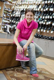 Woman trying shoes Stock Image