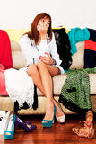 Woman chooses shoes for a party Royalty Free Stock Photography