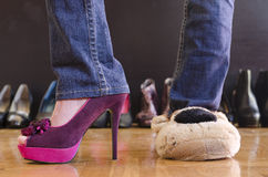 Woman trying on shoes at home Stock Photo