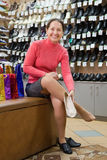 Woman trying shoes at shoes shop Royalty Free Stock Photos