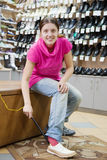 Woman trying shoes for size Stock Images