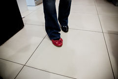 Woman trying on shoes in a store Stock Image