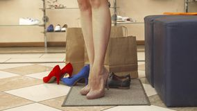 Woman legs trying beige shoes on close up royalty free stock photo