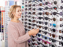 Woman trying spectacles frames Stock Photography