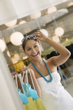 Woman Trying On Sunglasses In Clothing Store Stock Photography