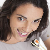 Woman trying sushi Stock Image