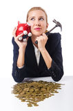 Woman trying to break  piggybank Royalty Free Stock Photo