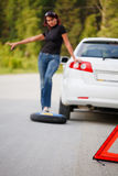 Woman trying to catch someone who may help her. Stock Images