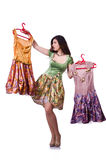 Woman trying to choose dress. On white Royalty Free Stock Photos