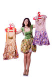 Woman trying to choose dress. On white Royalty Free Stock Image