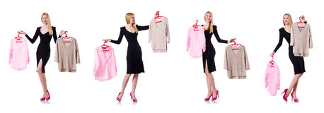 The woman trying to choose dress on white Stock Photography