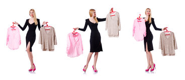 The woman trying to choose dress on white. Woman trying to choose dress on white Stock Images