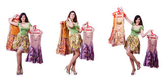 The woman trying to choose dress on white. Woman trying to choose dress on white Royalty Free Stock Image