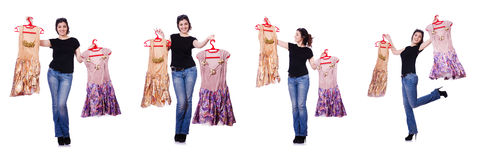 The woman trying to choose dress on white. Woman trying to choose dress on white Royalty Free Stock Photos