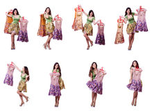 The woman trying to choose dress on white Royalty Free Stock Image