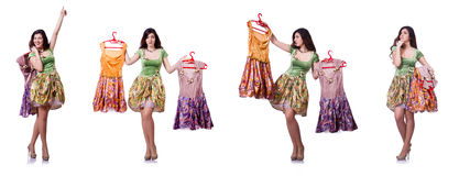The woman trying to choose dress on white Royalty Free Stock Photo