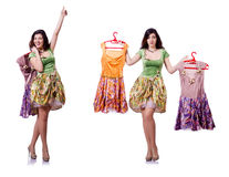 The woman trying to choose dress on white Royalty Free Stock Photos