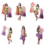The woman trying to choose dress on white. Woman trying to choose dress on white Royalty Free Stock Photo