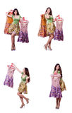 The woman trying to choose dress on white. Woman trying to choose dress on white Royalty Free Stock Photography