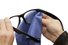 Woman Trying To Clean Glasses Royalty Free Stock Images
