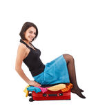 Woman trying to close her suitcase Stock Image