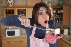 Woman caught in a mini kitchen Stock Photo