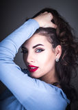 Glamorous woman pulling her hair Royalty Free Stock Photography
