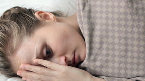 Woman trying to fall asleep stock video footage