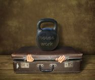 Suitcase under housework royalty free stock images