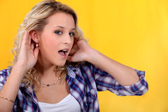 Woman trying to hear better Royalty Free Stock Photo