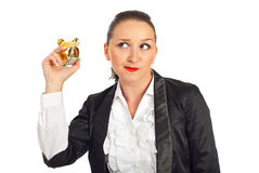 Woman trying to hear the sound of coins Royalty Free Stock Photography