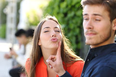 Woman Trying To Kiss A Man And He Is Rejecting Her Stock Image