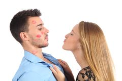 Woman trying to kiss a man desperately. Woman trying to kiss a men desperately isolated on a white background Stock Photo