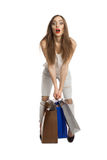 Woman trying to lift shopping bags Stock Photo