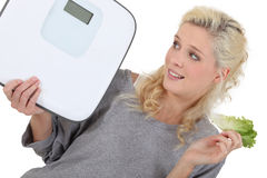 Woman trying to lose weight. By eating healthy food Royalty Free Stock Photography