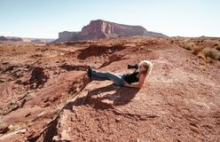 Woman trying to make photos in Monument Valley. Stock Images