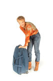 Woman trying to open her suitcase Royalty Free Stock Images