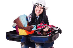 Woman trying to pack too much isolated Royalty Free Stock Images