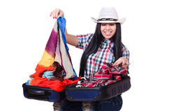 Woman trying to pack too much isolated Royalty Free Stock Photos