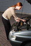 Woman Trying to Repair a Car Stock Photo