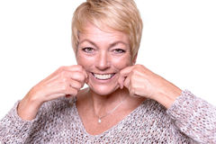 Woman trying to reverse the signs of aging Stock Photo