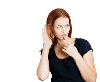 Woman trying to secretly listen Stock Images
