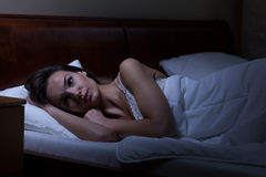 Woman trying to sleep. In her bed Stock Photography