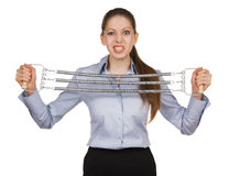 Woman trying to stretch the metal expander Royalty Free Stock Image