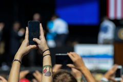 Woman trying to take a picture of President Obama on stage Lake Tahoe Summit Stock Photo