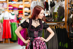Woman is trying Tracht or dirndl in a shop Stock Images