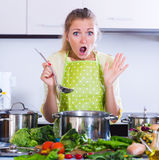 Woman trying unpatable meal Royalty Free Stock Photos
