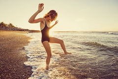 woman trying water in the ocean stock image
