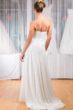 Woman trying wedding dress in shop. Woman trying on wedding dress or bridal gown in wedding fashion store Stock Photography