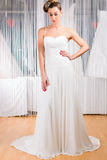 Woman trying wedding dress in shop. Woman trying on wedding dress or bridal gown in wedding fashion store Stock Image